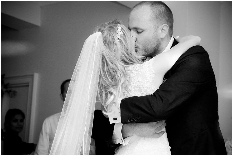 Bride and groom kissing during first dance black and white portrait linden house hammersmith london wedding photography