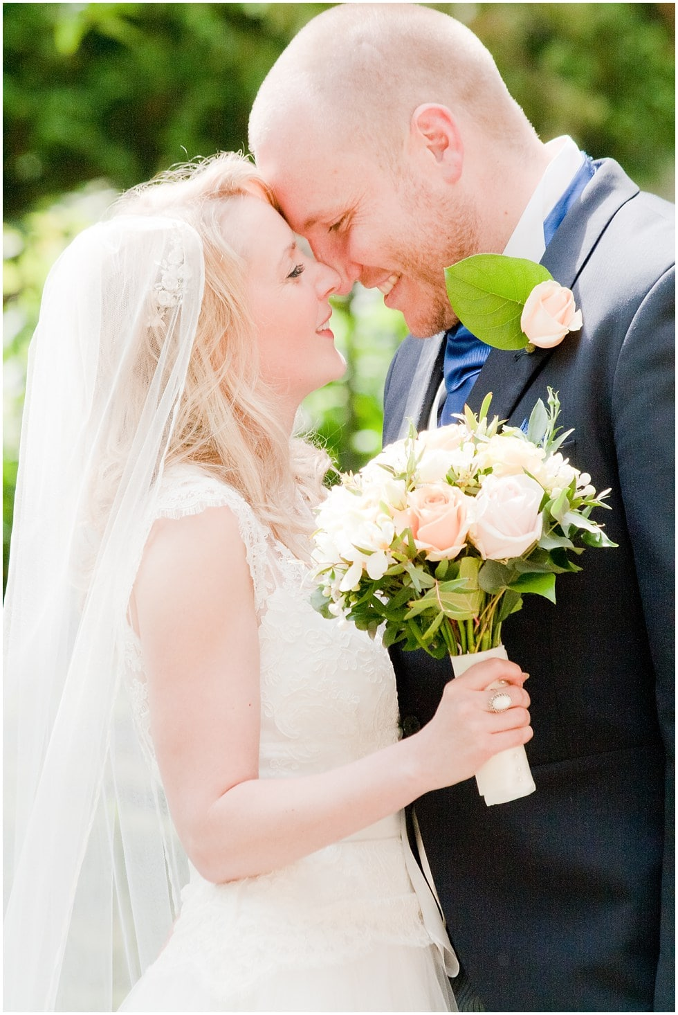 Beautiful couple shot of bride and groom foreheads together St Nicholas Church Chiswick London