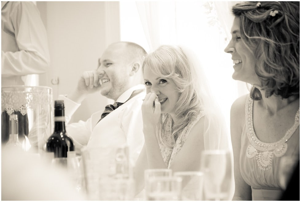 Bride laughing during the speeches at Linden House Hammersmith London Wedding