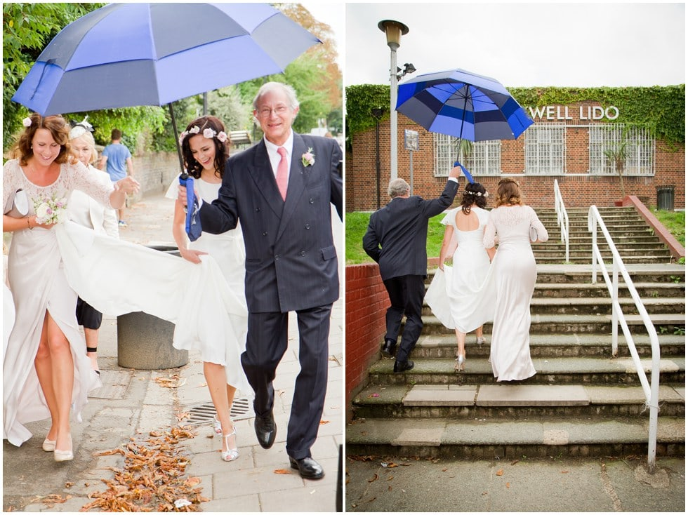 Bride walking in the rain to the Lido Herne Hill
