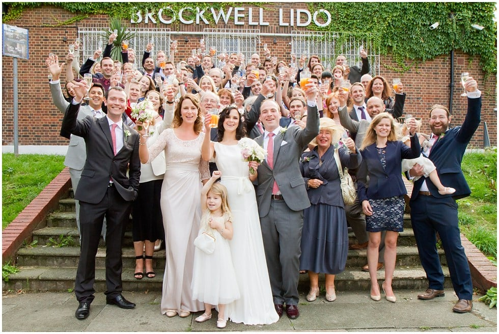 The whole group at a Lido Herne Hill Wedding Cheering