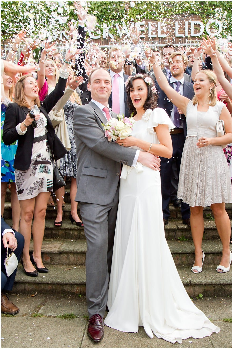 The moment the confetti is thrown at the bride and groom Herne Hill Wedding