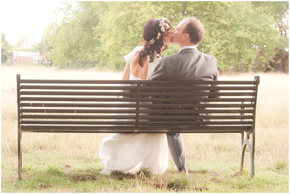 Newly weds kissing on a bench in Brockwell Park Herne Hill