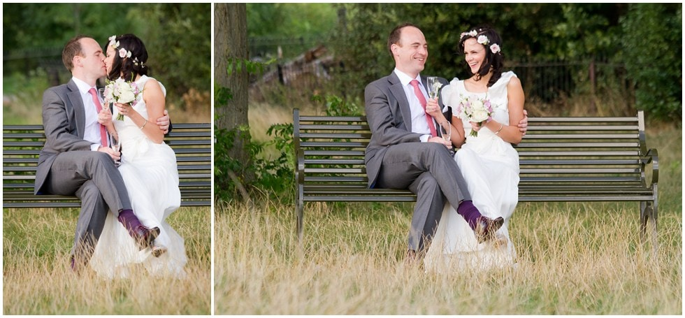 Bride and groom enjoying laughter on a Brockwell Park bench London Wedding Photography