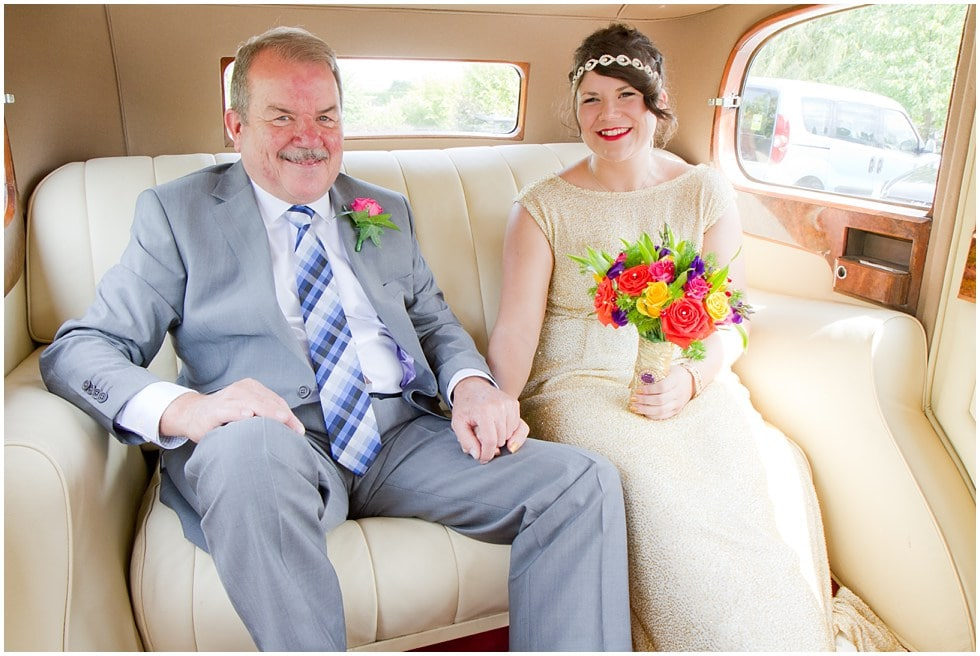 Bride and father in the back of the rolls royce