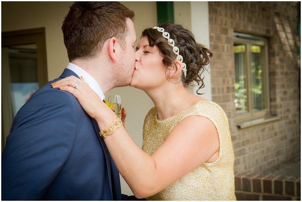 bride and groom impromptu kiss