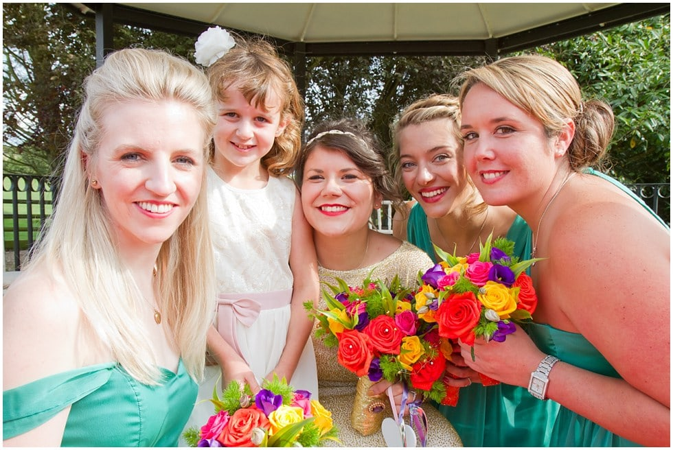 Bridesmaides in front of bandstand at the three rivers golf and country club cold norton