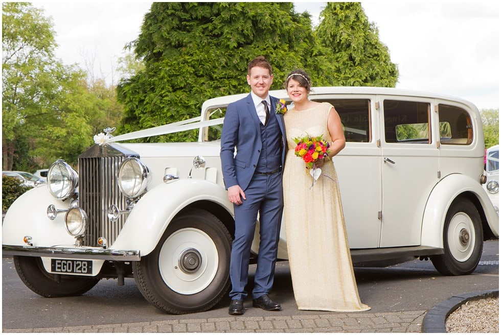 bride and groom in front of Rolls Royce wedding photography