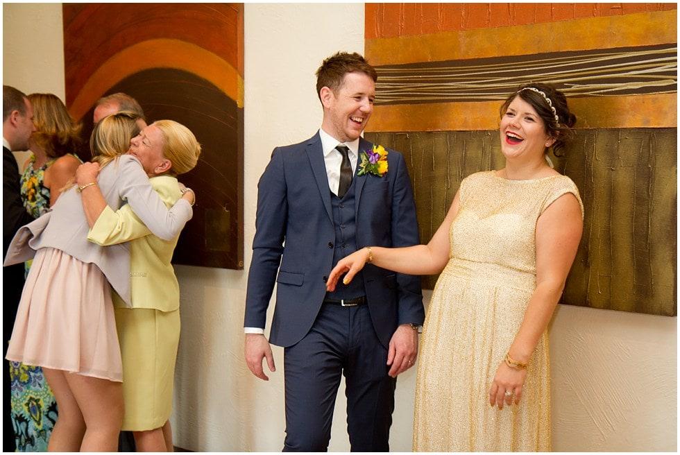 bride and groom cracking up informal wedding shot