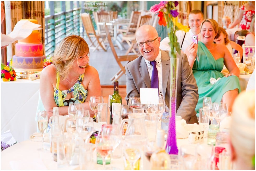 groom's parents cracking up at best man's speech essex wedding photography