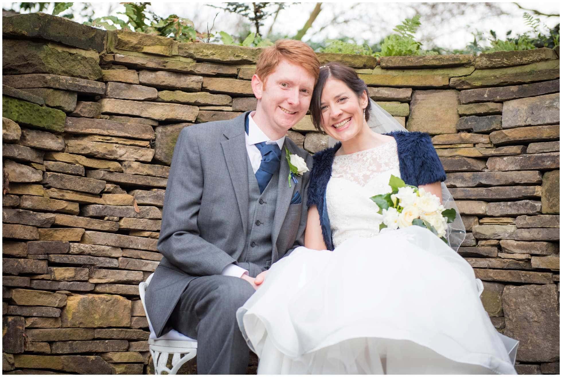 Marriott Hotel York Wedding Photographer Winston Sanders shot of beautiful bride and group on bench in garden