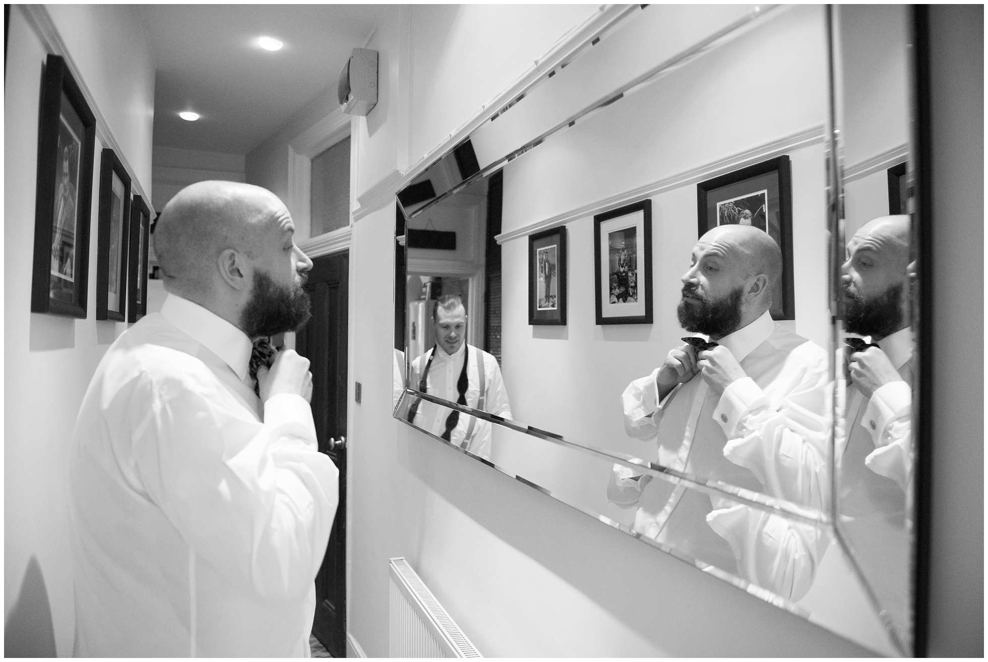 Black and white shot of grooms getting ready for their islington wedding