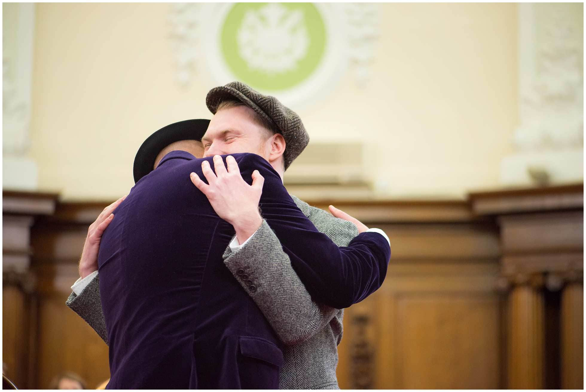 hugs at gay wedding photography islington town hall