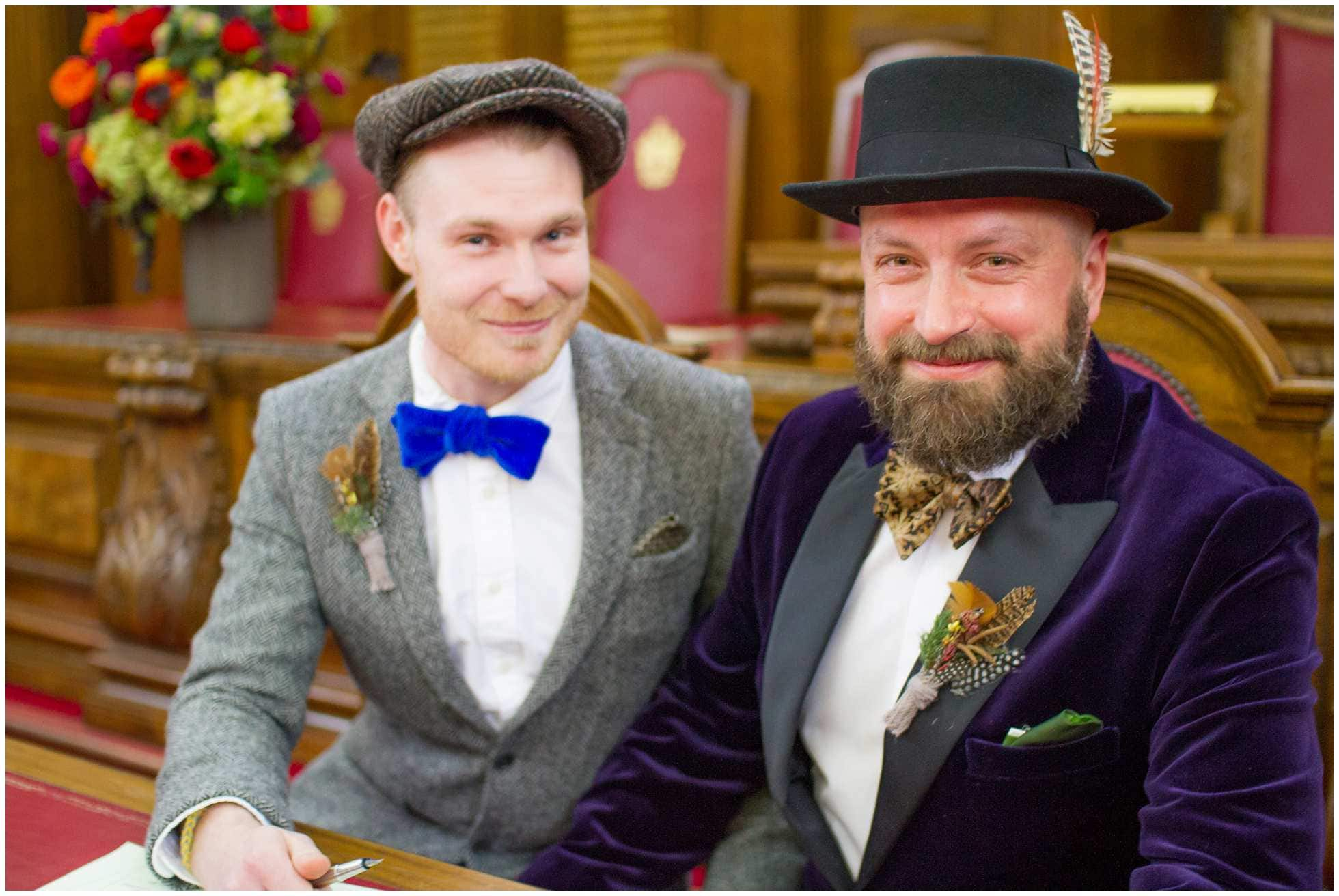 Signing the register at islington town hall gay wedding photographer