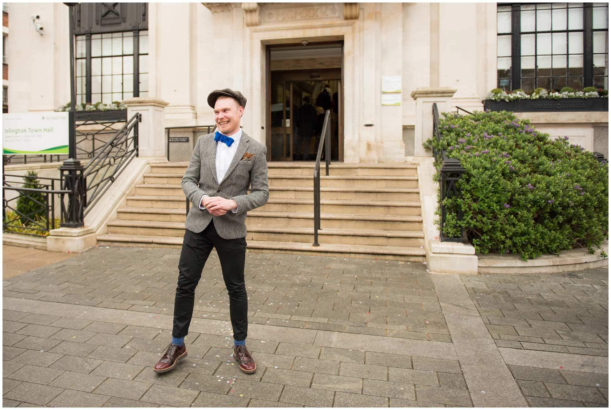 Happy groom on steps of islington town hall
