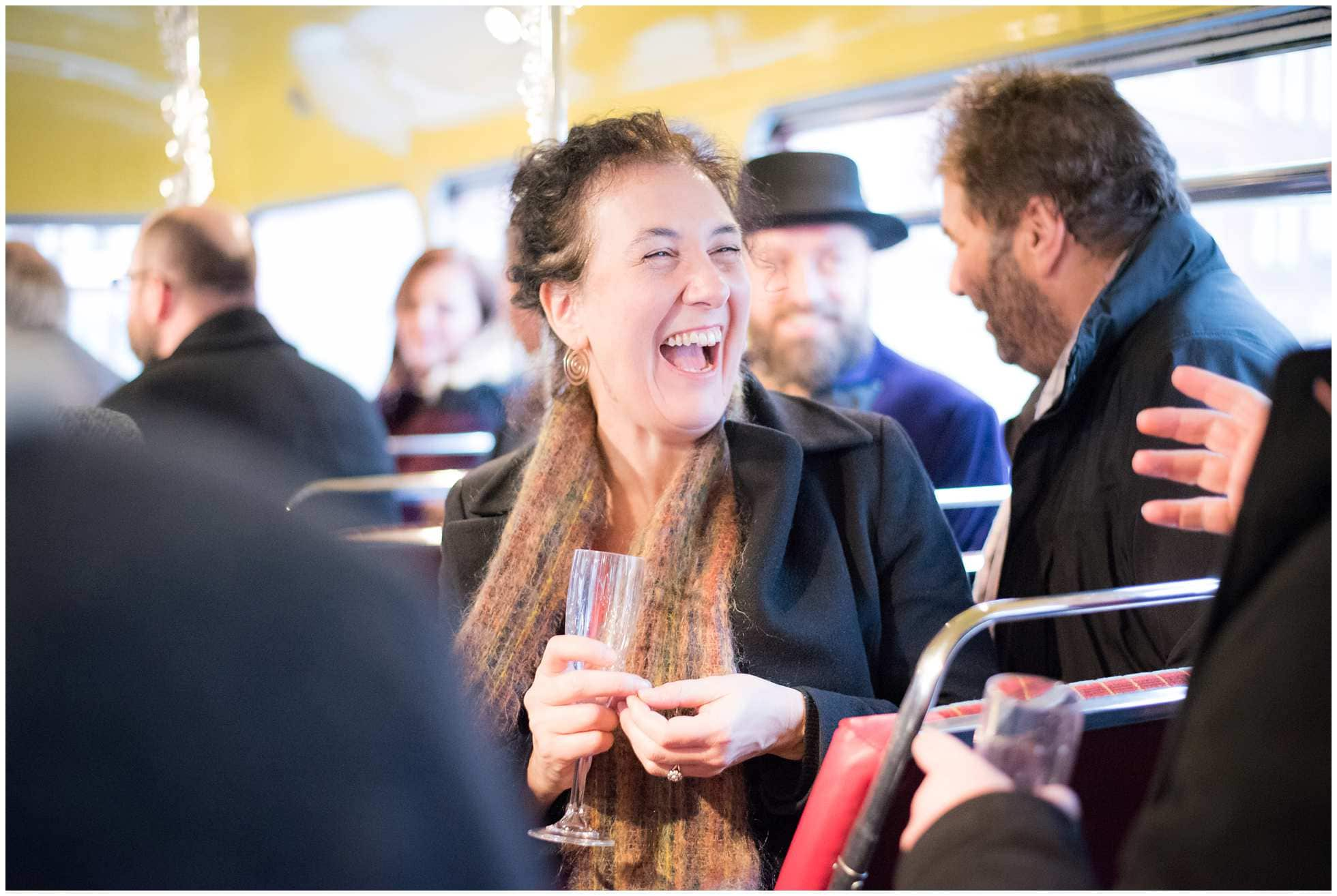 Laughing lady on Routemaster bus london wedding photography
