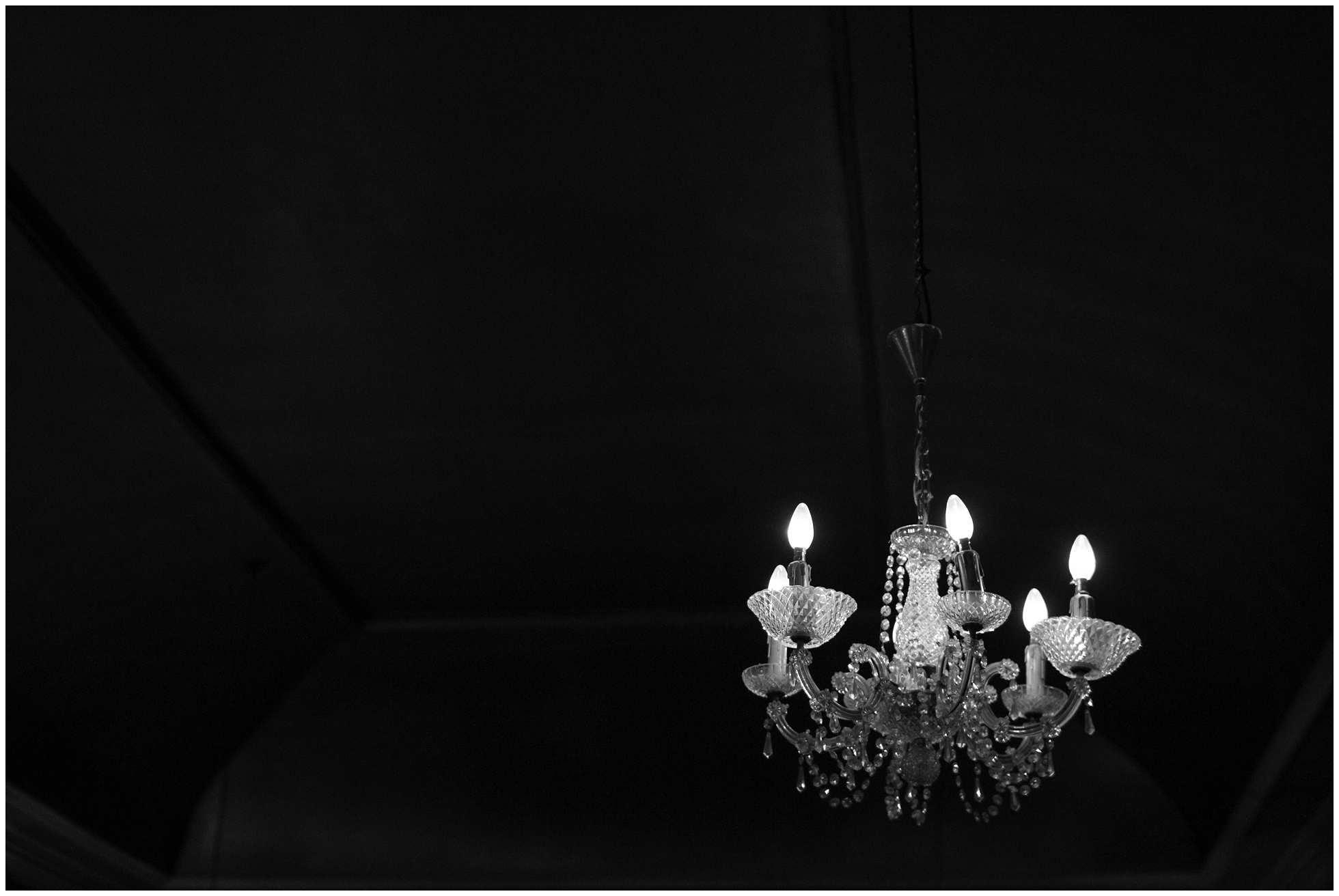 chandelier black and white london wedding photography