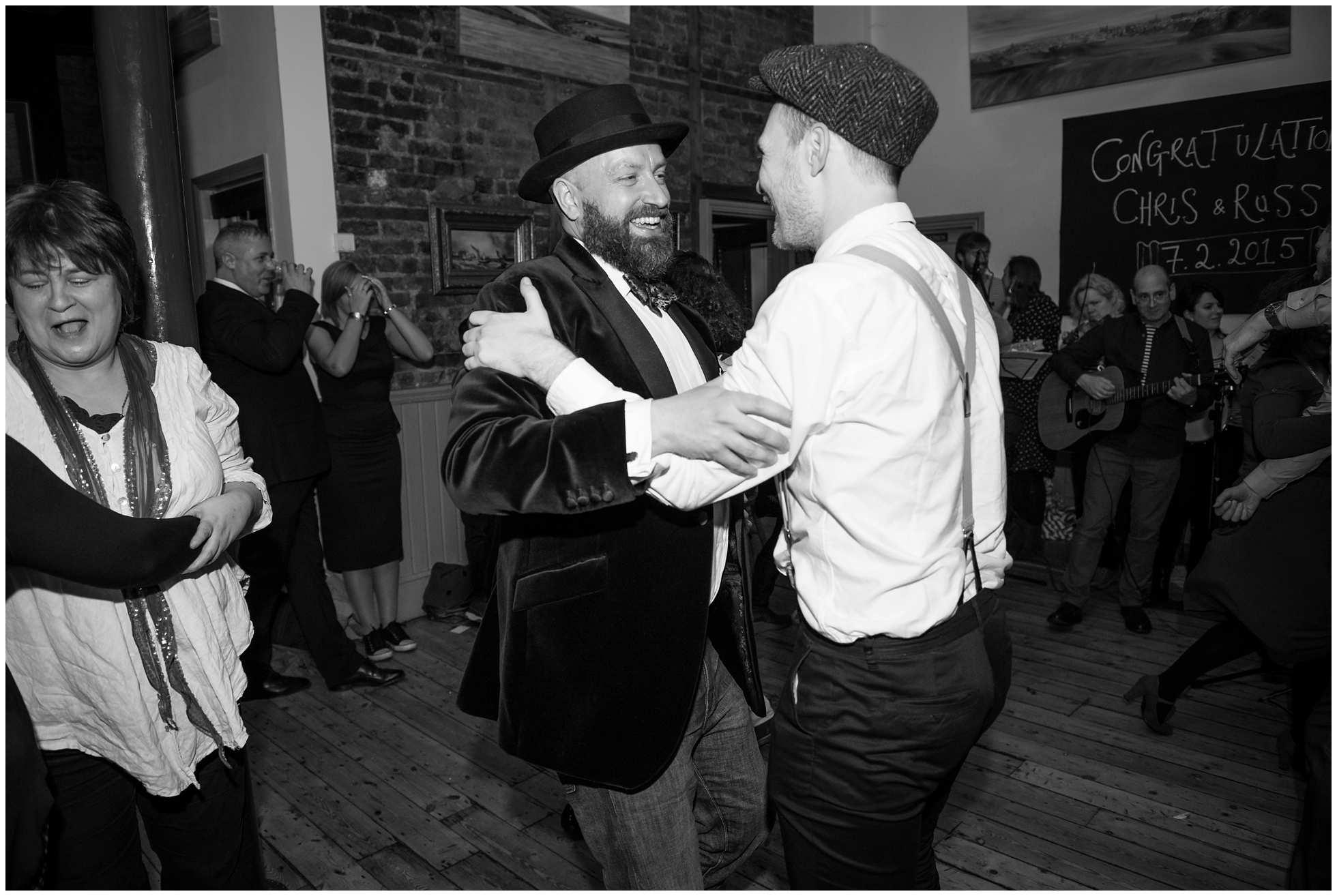 Dancing merrily - gay wedding ceilidh reception at the star london