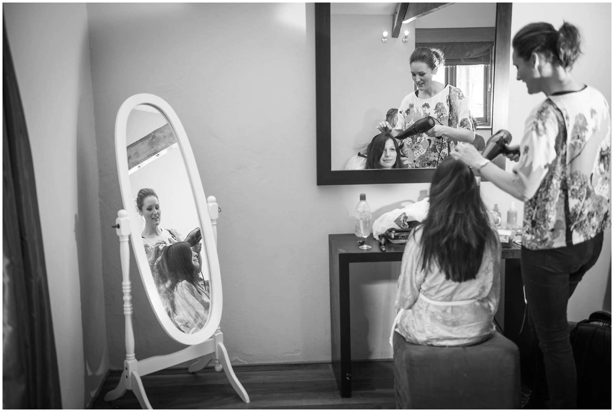 bride getting ready black and white mirrors