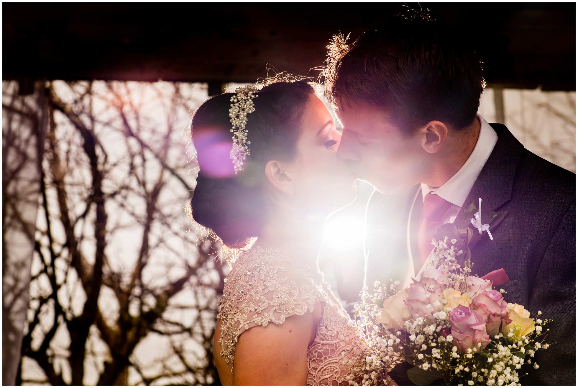 Pow! Backlit awesome shot of Bride and groom kissing Trevena Cornwall Wedding Photography