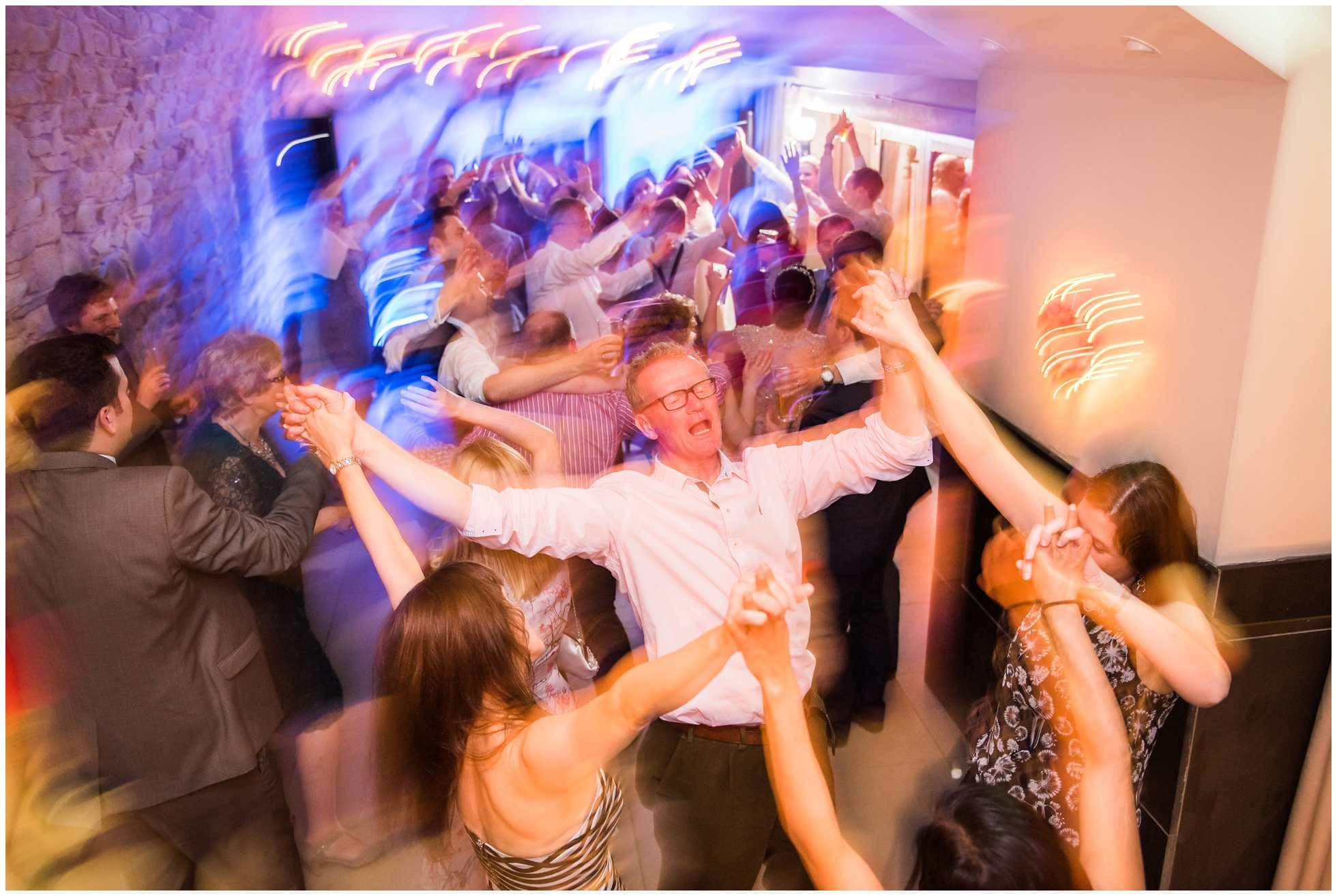 Dance floor shot of crowd enjoying the wedding of the year at Trevena Cornwall
