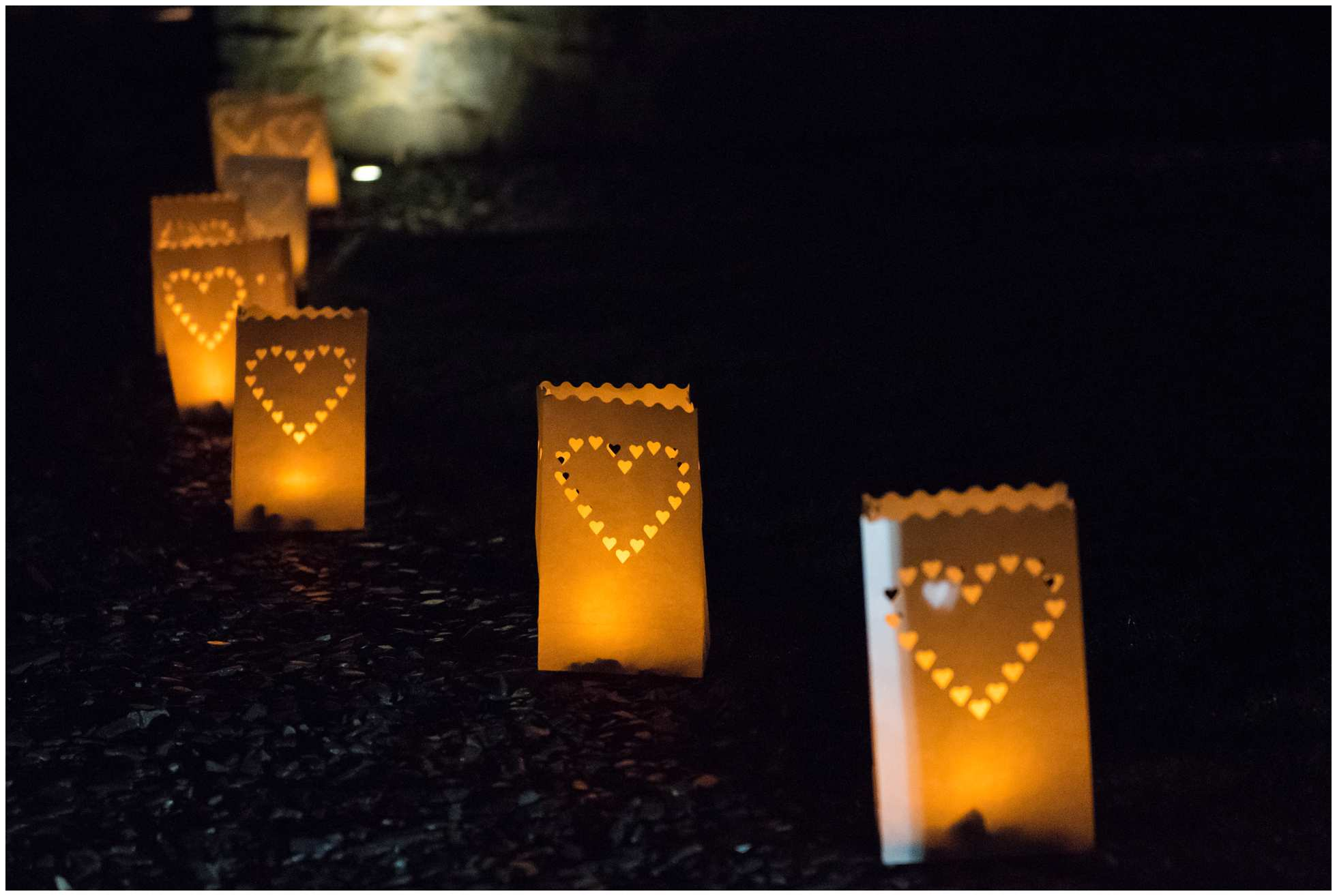 Candle lanterns leading to the wedding hut