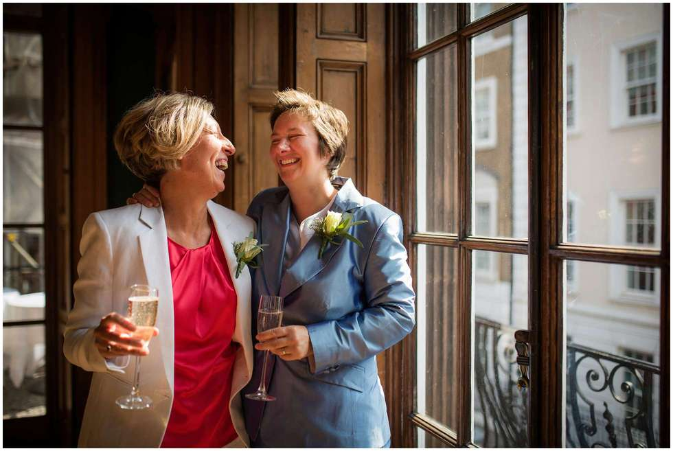 Relaxed wedding photography at the University Women's Club, London! Judith and Deborah in fits of laughter!