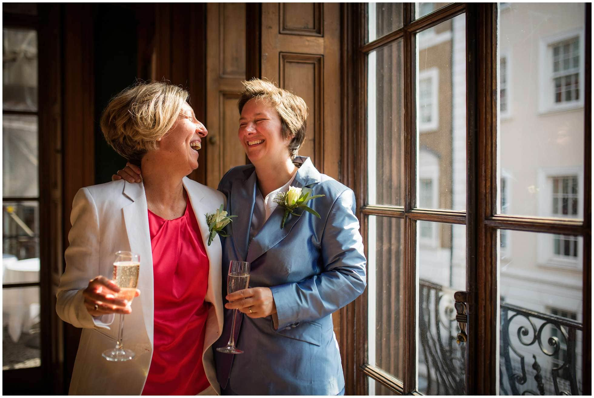 Relaxed wedding photography at the University Women's Club! Judith and Deborah in fits of laughter!
