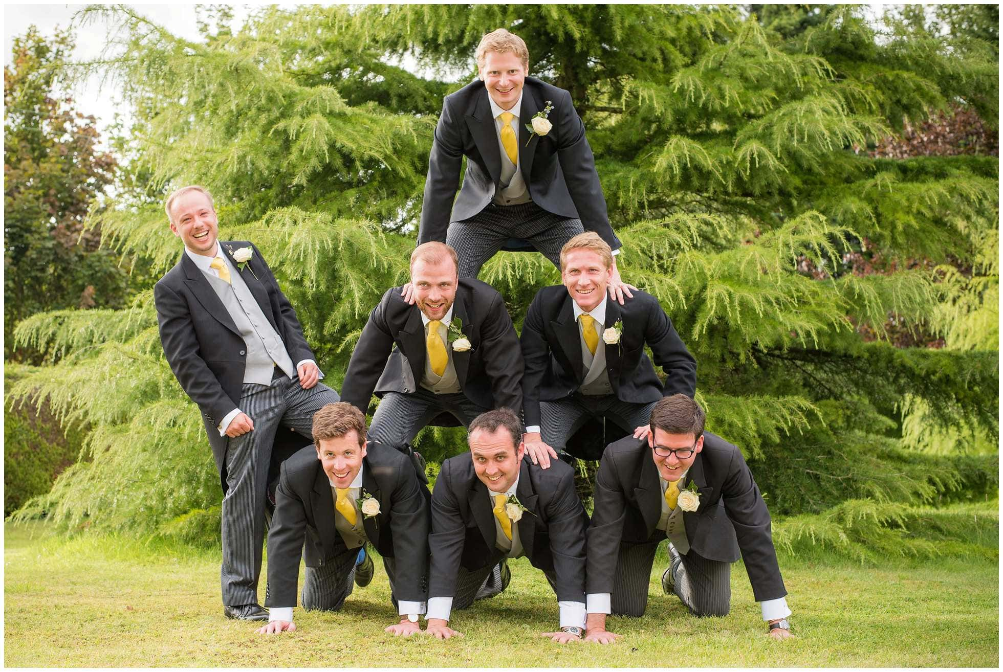 Human pyramid of groomsmen wedding photography