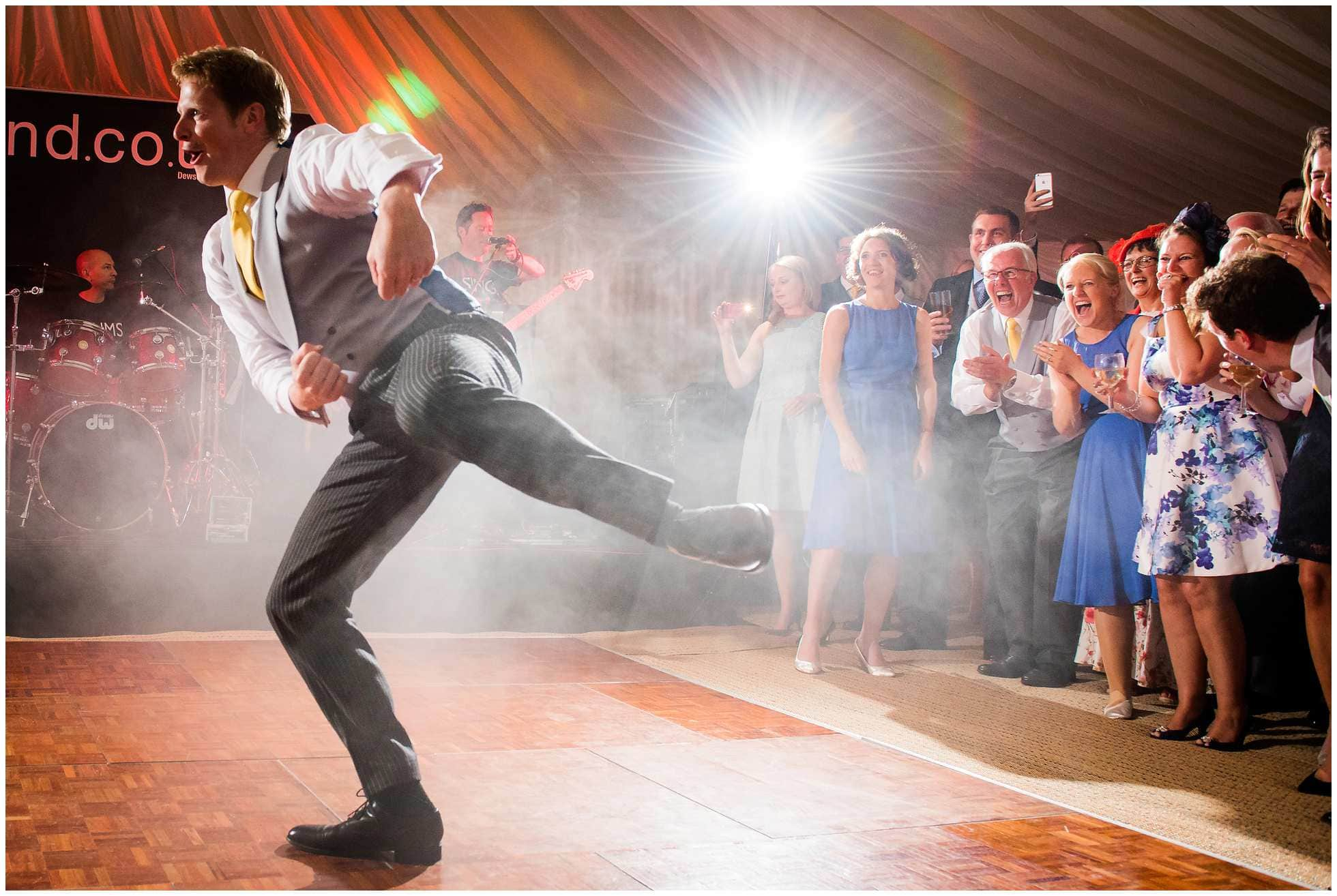 Father of bride pissing himself with laughter at the groom's dancing