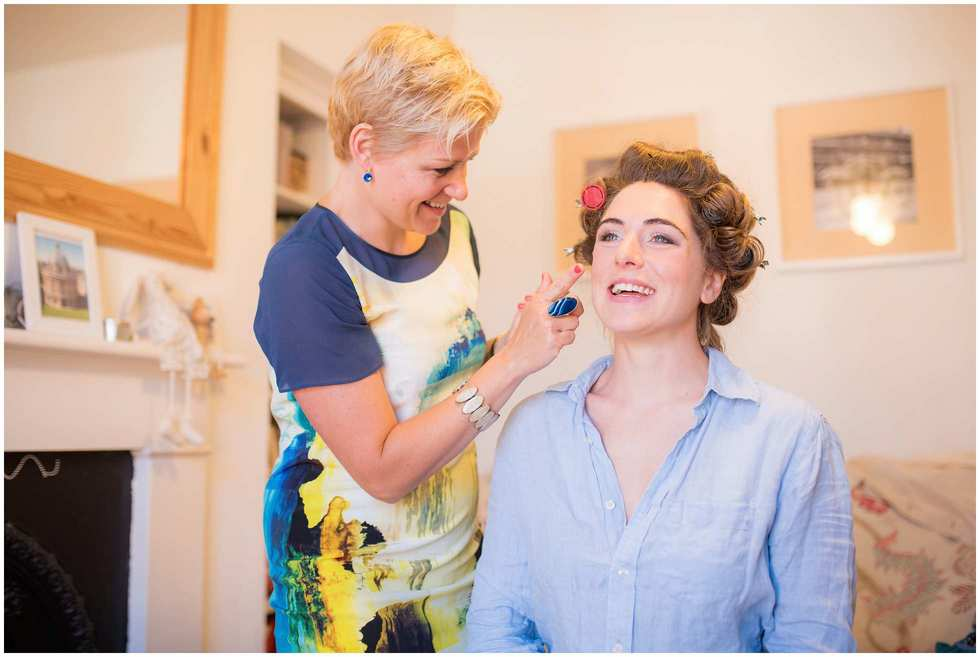 Laughter as make up is applied Oxford Wedding Photography
