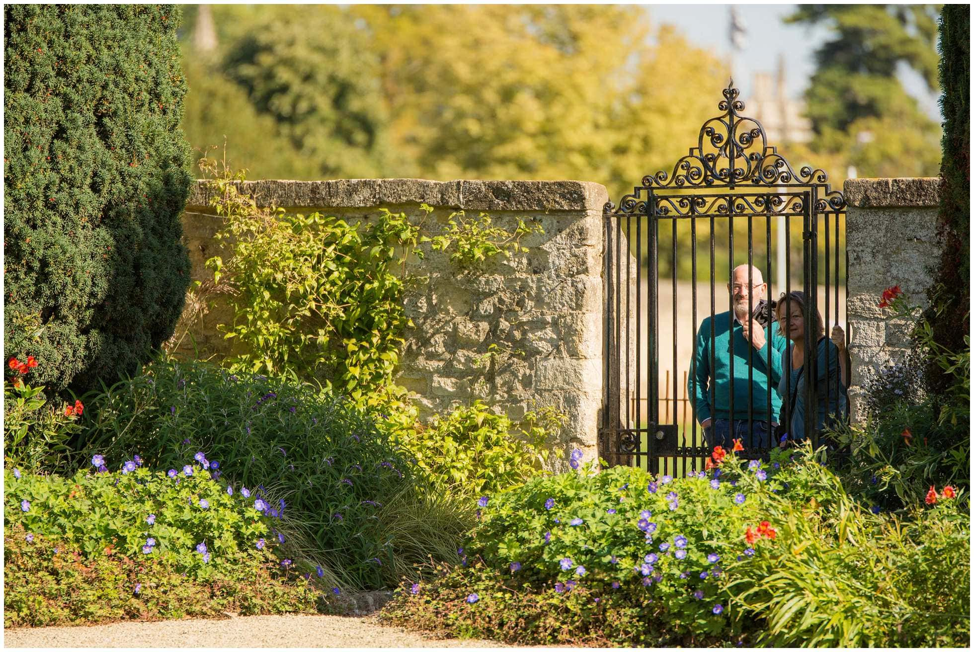 Tourists peeping into the Master's garden