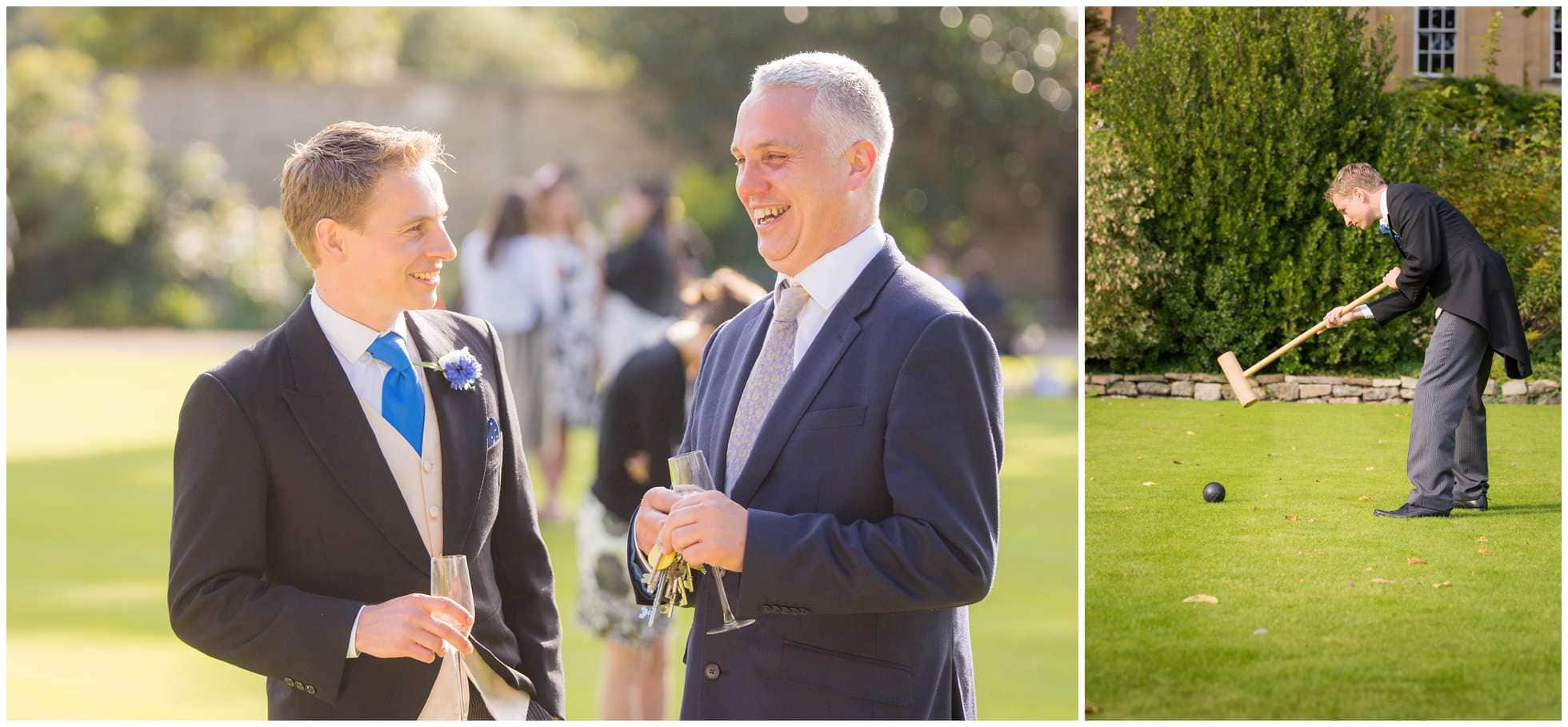 The groom playing croquet and talking to wedding organiser