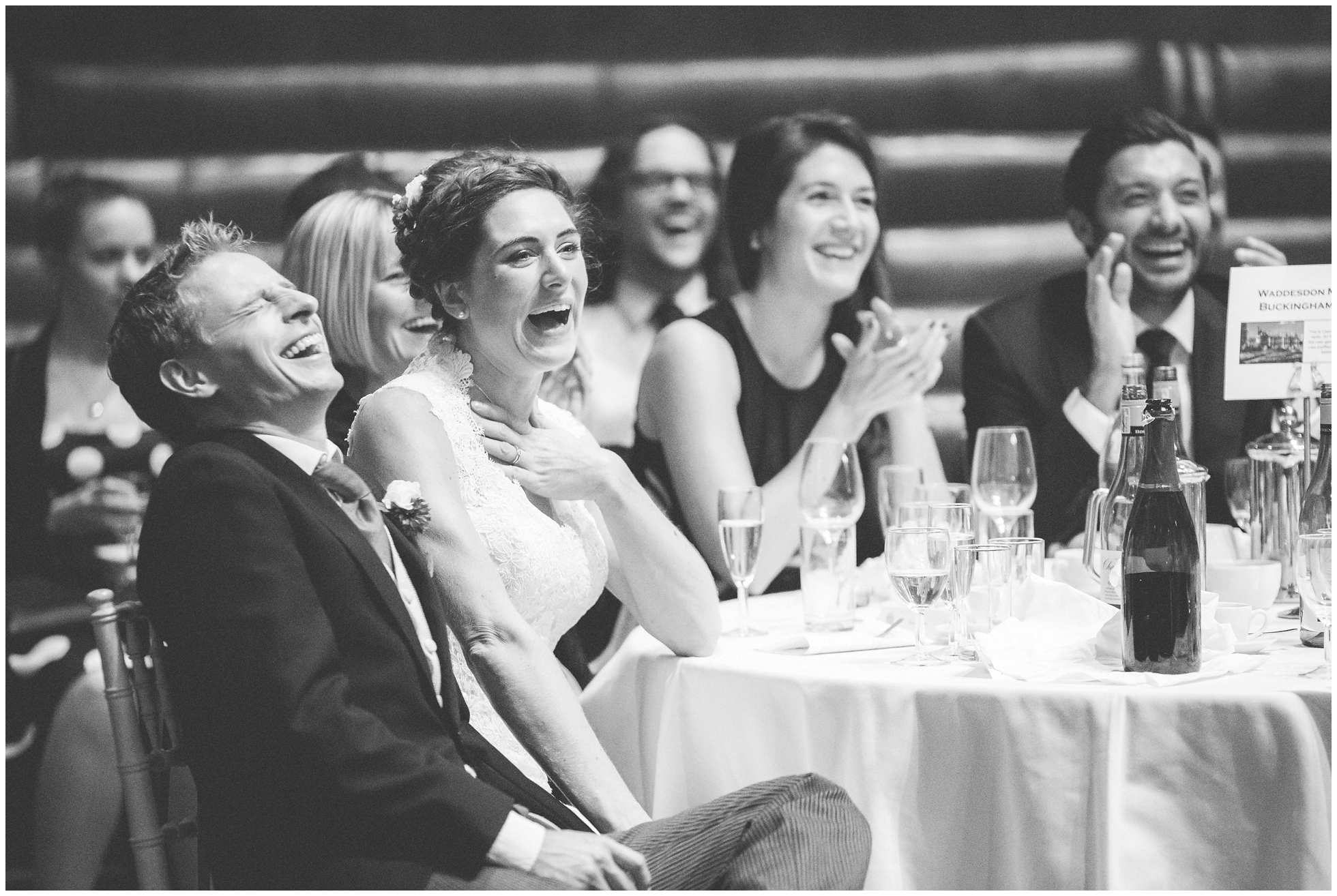 Bride and Groom laughing at Oxford Union
