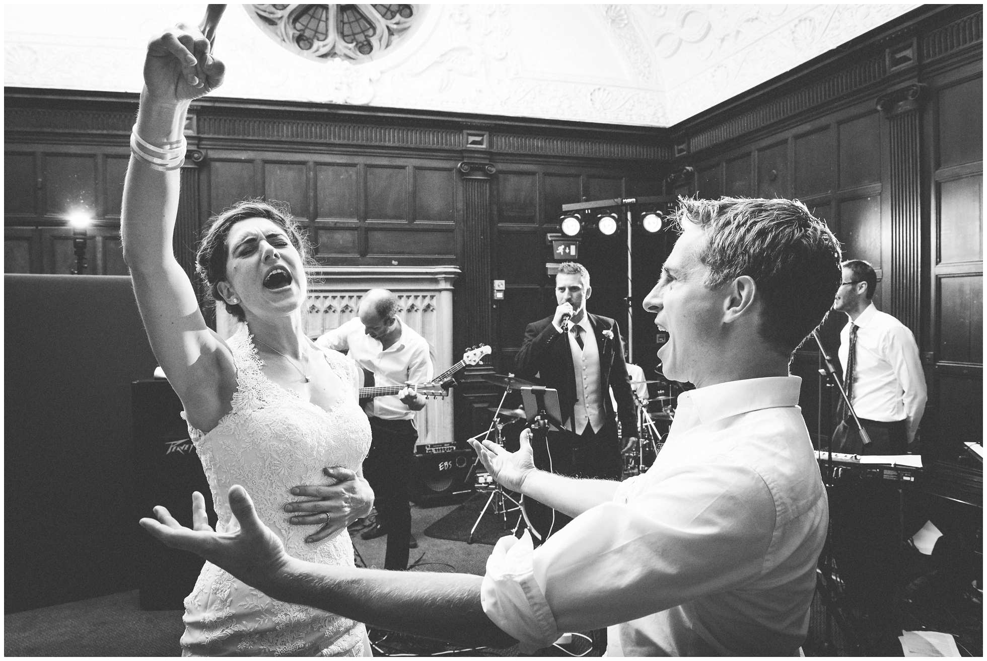 Bride and groom singing along to
