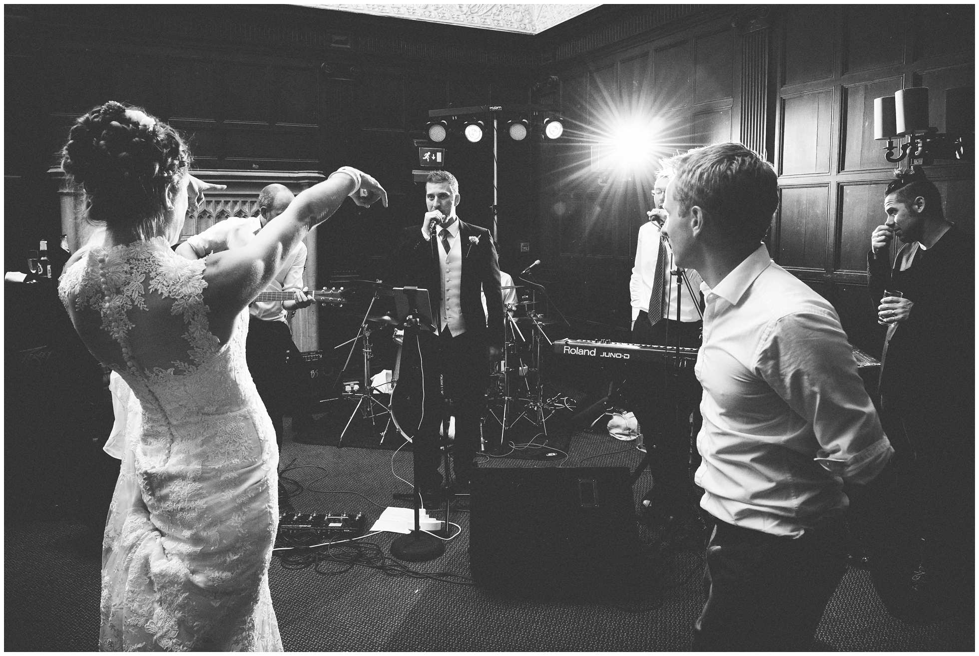 Bride and groom singing along and pointing to