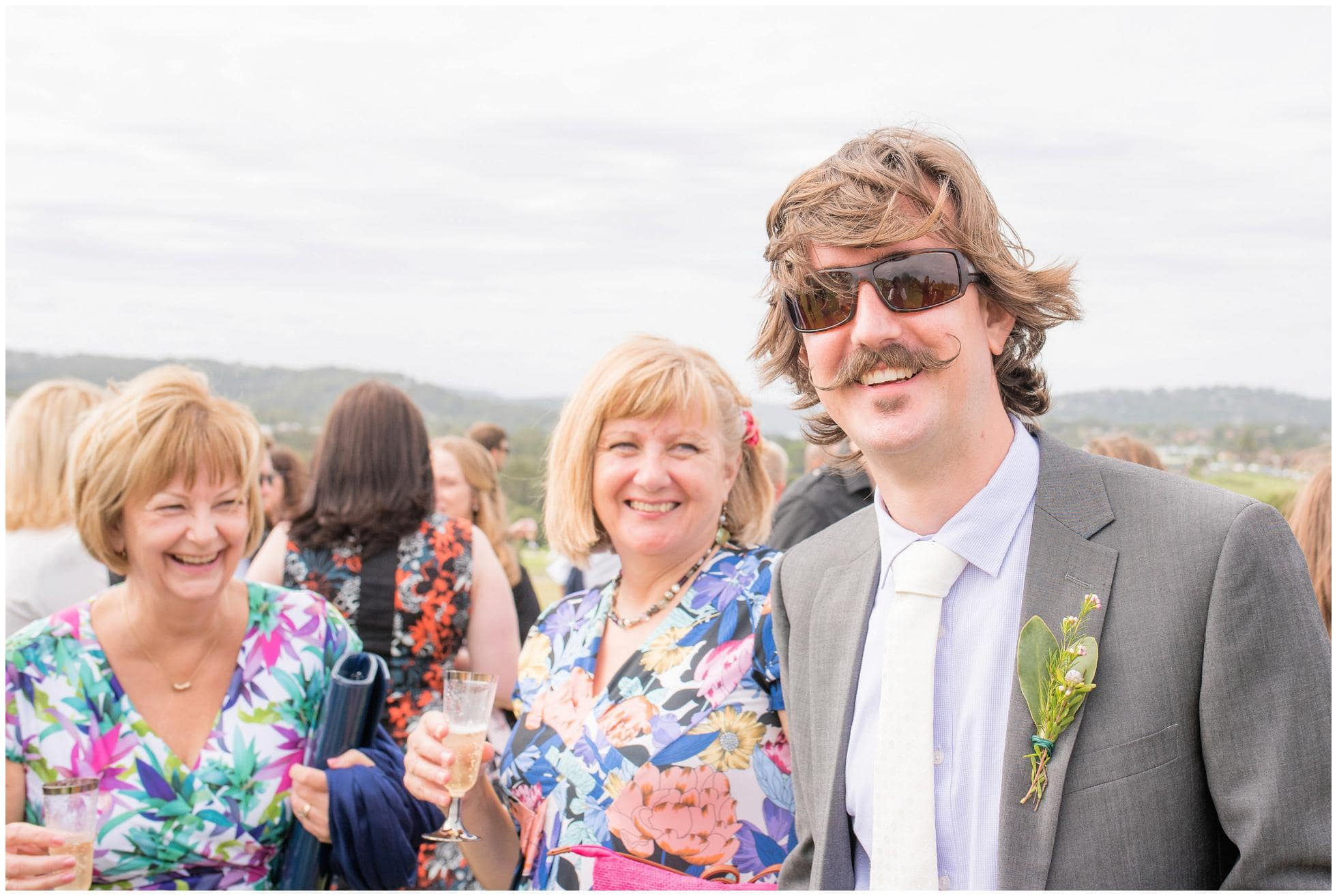 The groom with his Mum and aunts enjoying a relaxed wedding photography moment