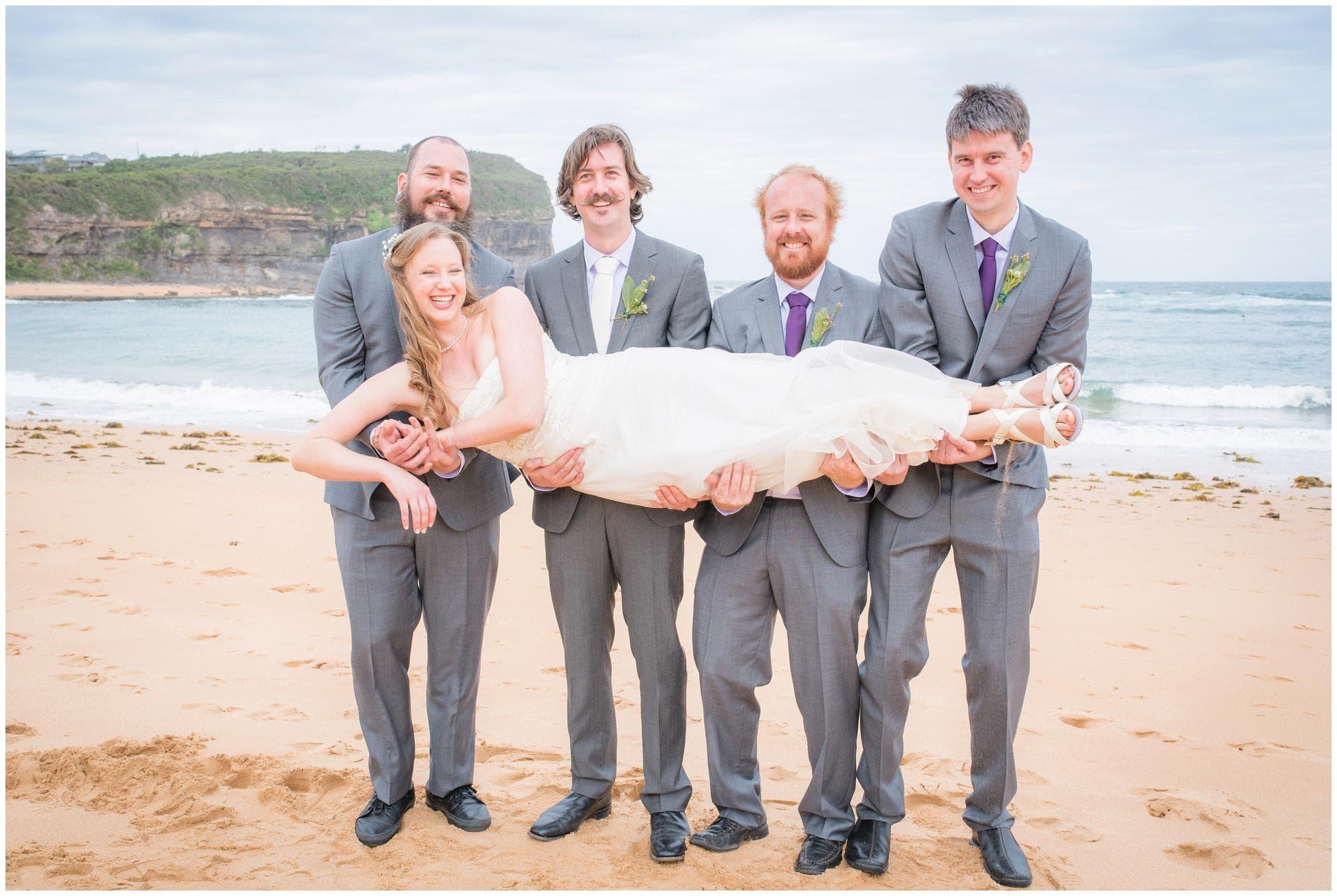 Groomsmen holding the bride on Mona Vale beach, Sydney, Australian Wedding