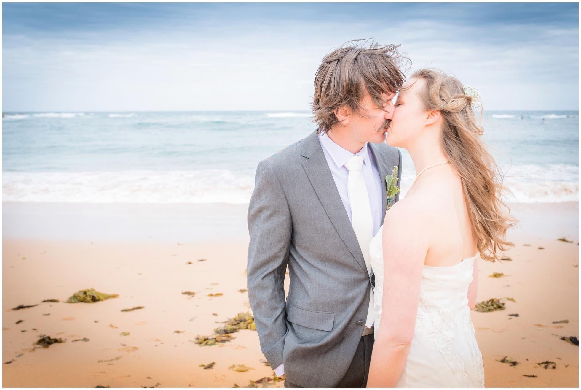 Bride and Groom kssing on the Mona Vale beach - a Sydney wedding photographer's dream wedding