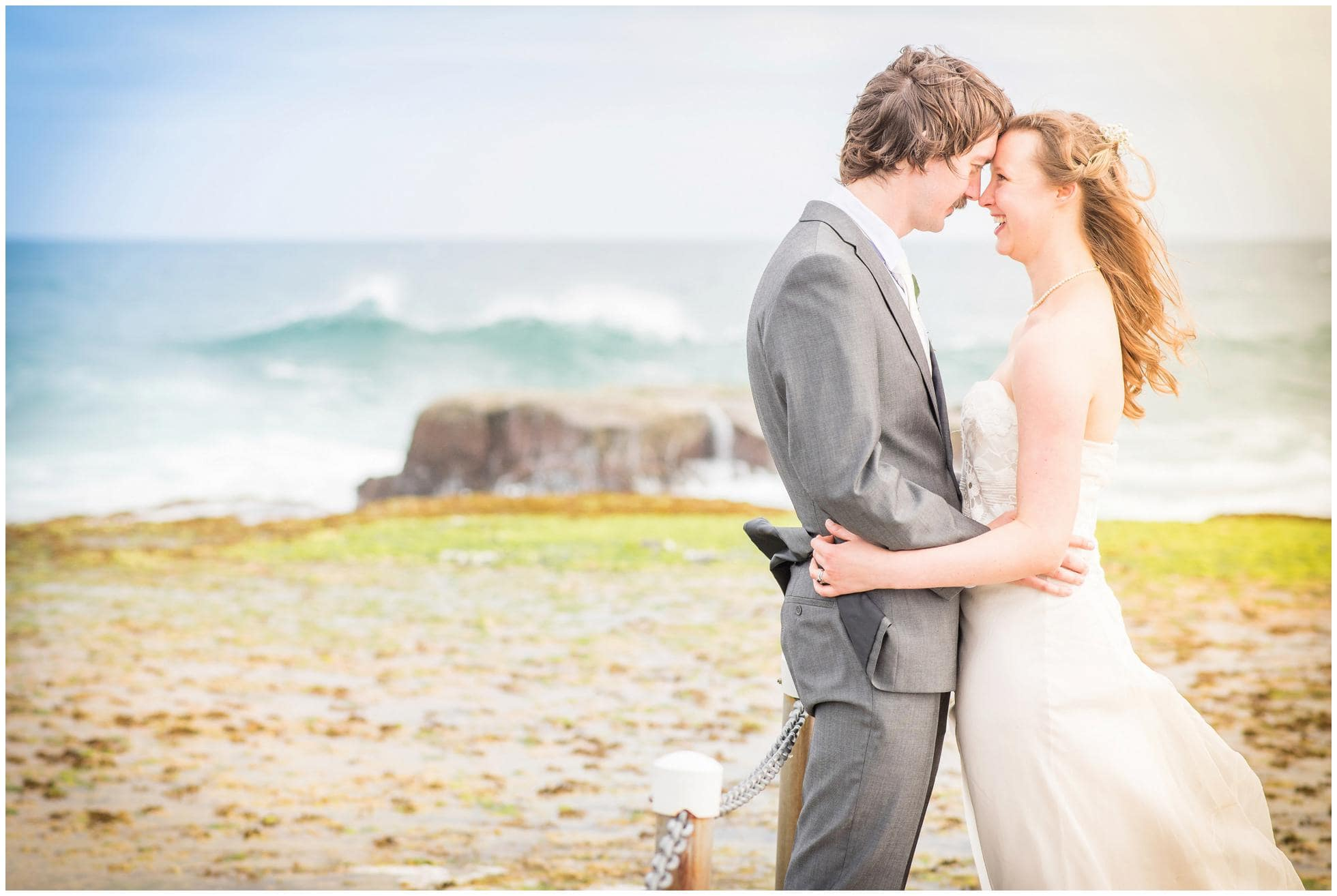 Mona Vale Wedding Photography Australia. Bride and Groom enjoying each others embrace on the rocks.