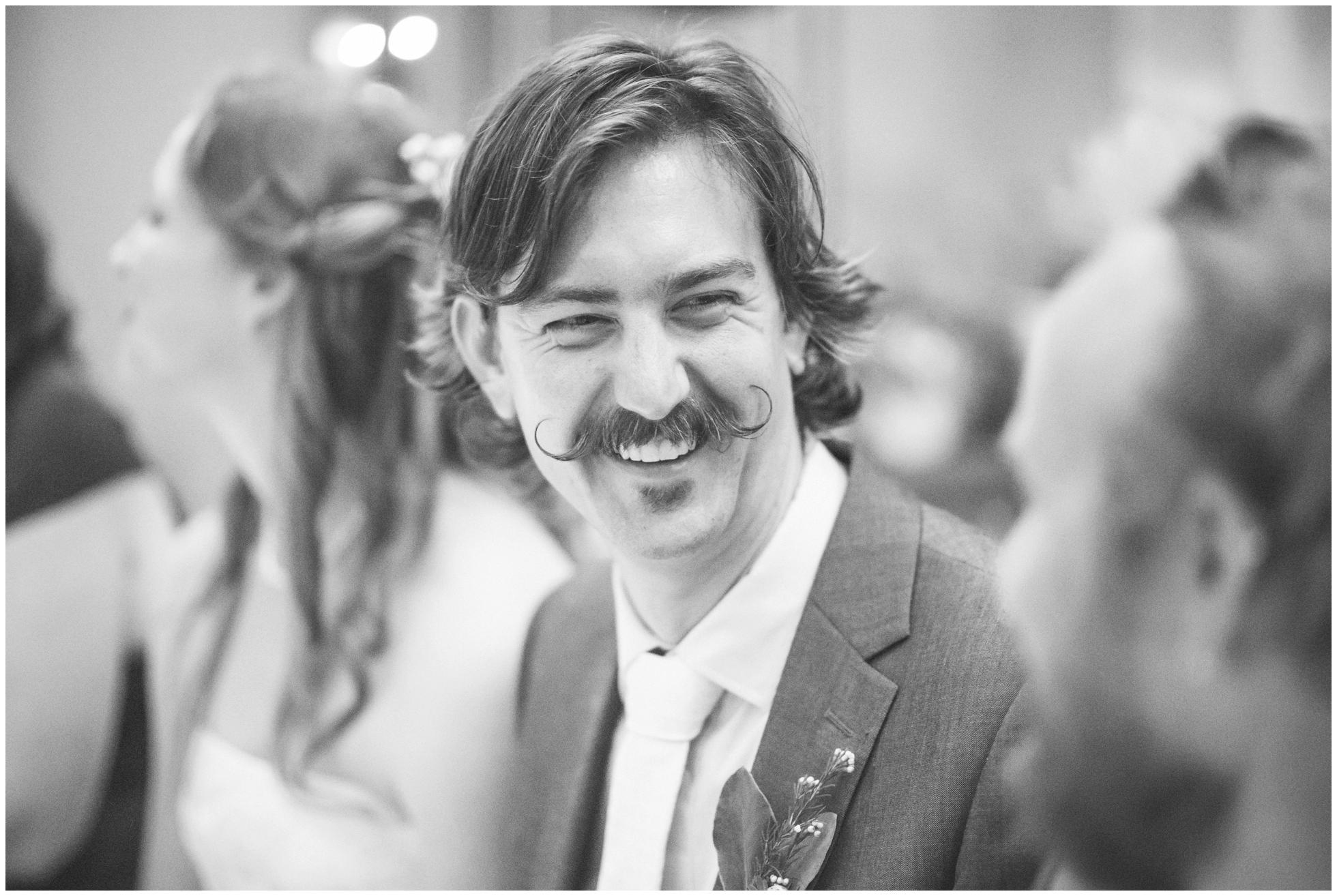 Son's laughter at his Sydney wedding. Handlebar moustache on show!