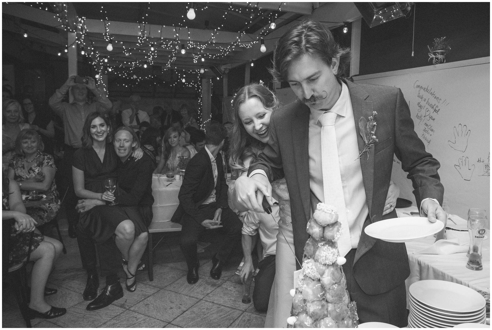 Cutting the cake at Das Bierhaus, Mona Vale, Sydney wedding