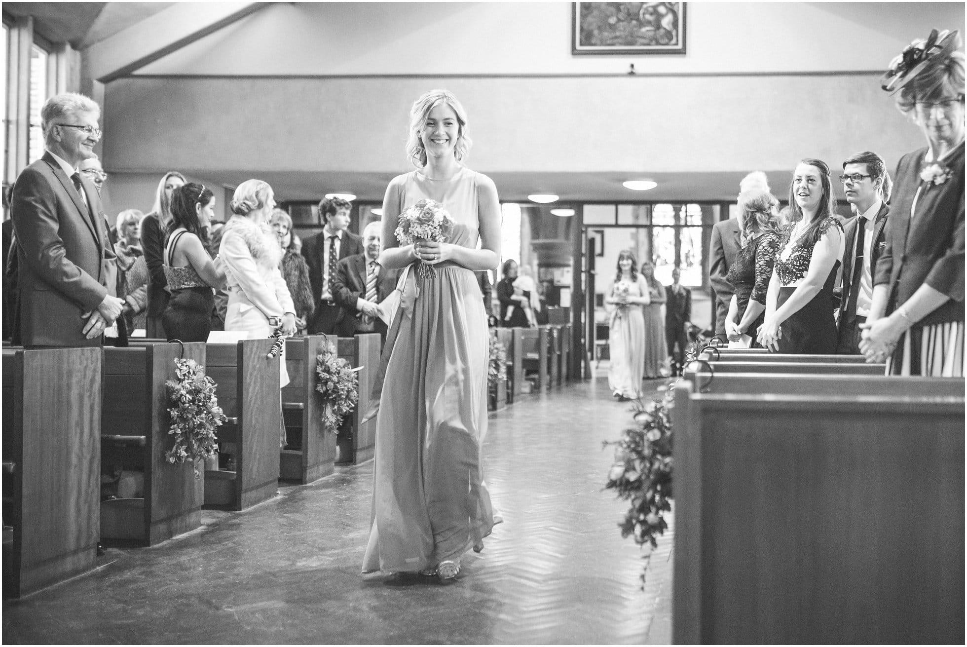 Beautiful bridesmaids walk down the aisle