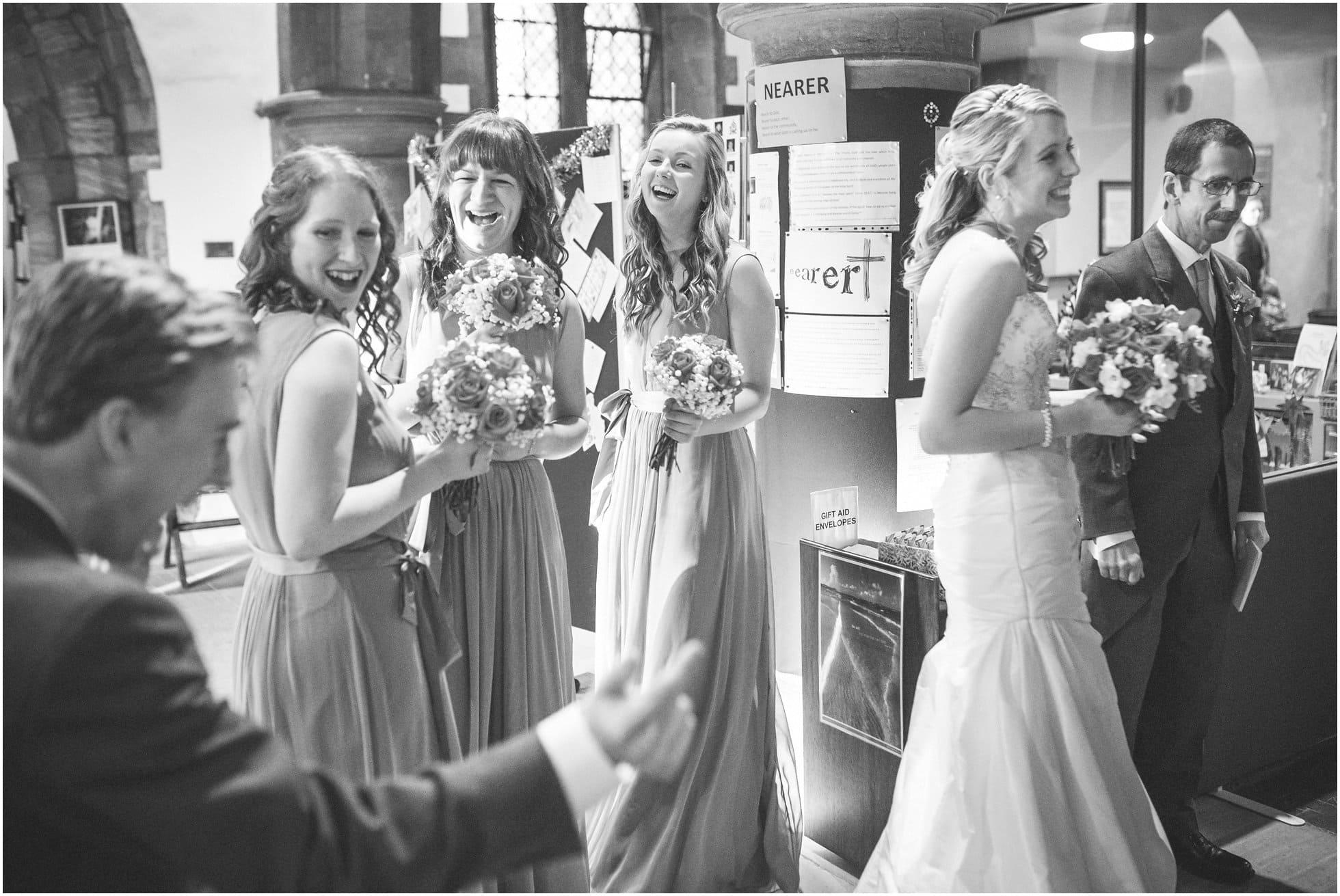 Bridesmaids laughing inside Birstall church