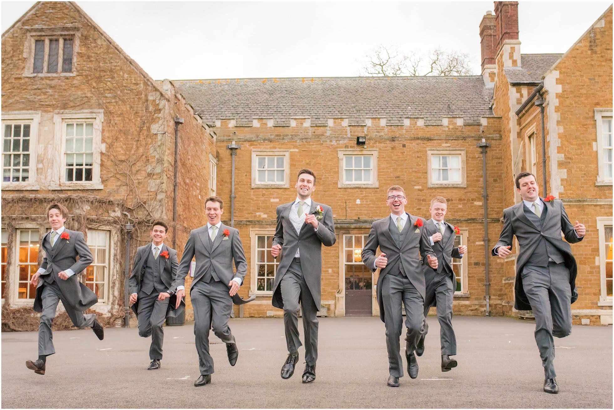 The groomsmen running in front of Brooksby Hall, Leicestershire