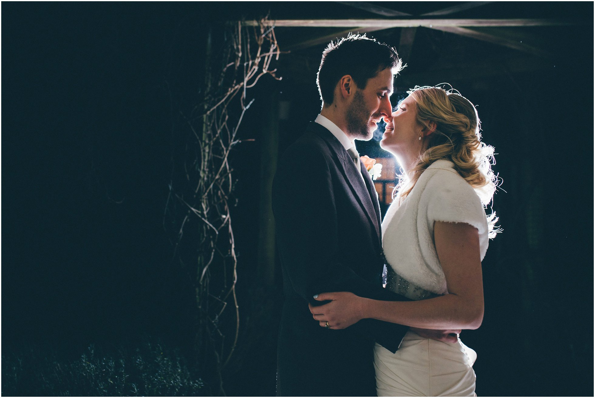 Backlit portrait shot of the bride and groom shot by the Brooksby Hall Wedding Photographer Winston Sanders