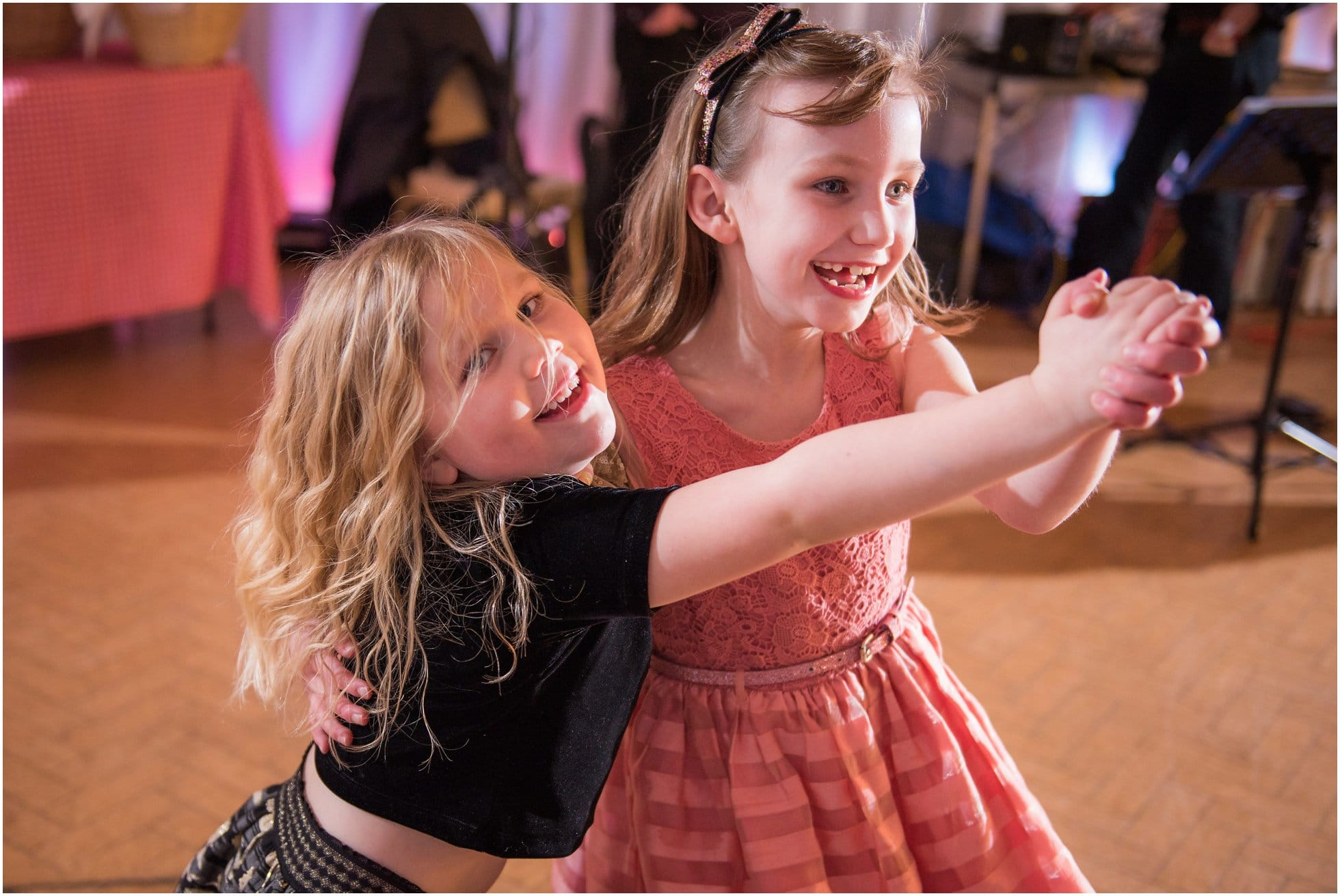 Girls copying the bride and groom dancing