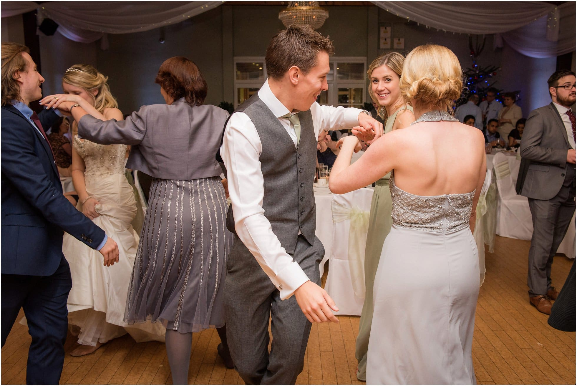 the best man and head bridesmaid dancing