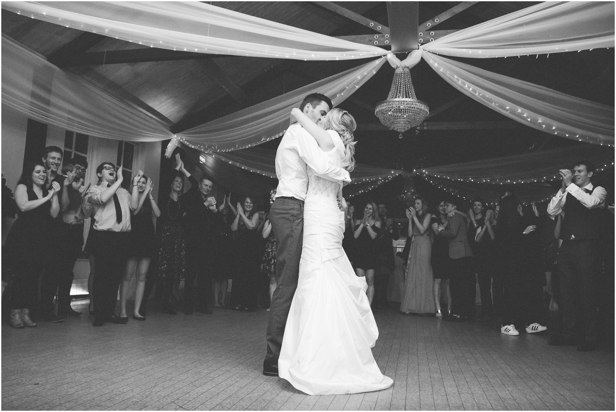 The happy couple applauded by their friends and family at a Brooksby Hall Wedding Photographer's dream wedding!