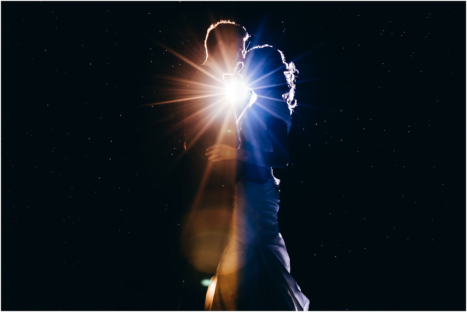 Brooksby Hall Wedding Photographer creative backlit nighttime shot